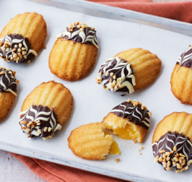 Rahul's Chocolate-dipped Orange Madeleines